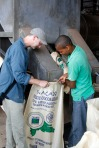 Here Tim and Adán are filling a bag with dried beans.  Ready to ship!  I ate a bean from the bag.  It was the bitterest chocolate I've ever tasted.  The beans themselves don't have any sugar—just chocolate and fat—so they have to add sugar later.