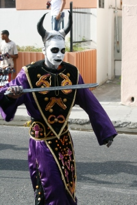 A costumed participant in the Carnaval parade in Bani.